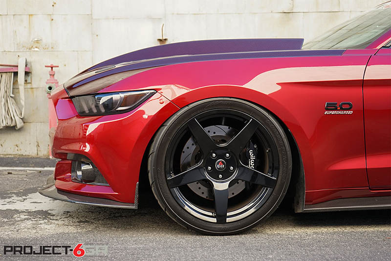 set of black Mustang wheels